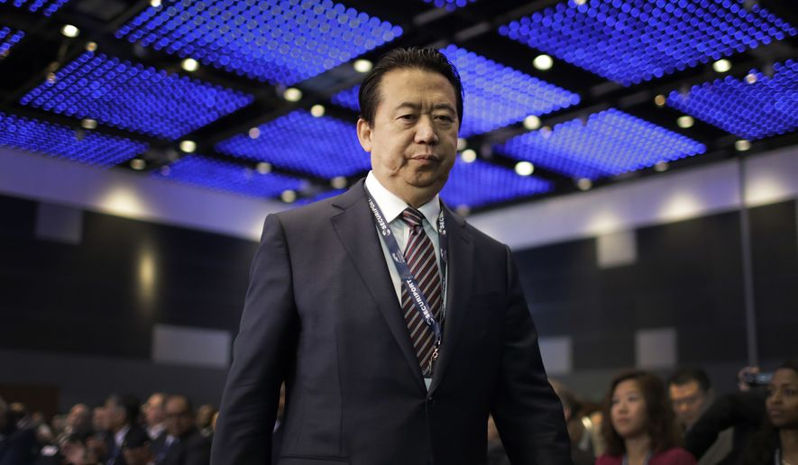 In this July 4, 2017, file photo, Interpol President, Meng Hongwei, walks toward the stage to deliver his opening address at the Interpol World congress in Singapore. A French judicial official says Friday Oct.5, 2018 the president of Interpol has been reported missing after traveling to China. (AP Photo/Wong Maye-E, File)