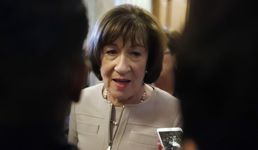 Sen. Susan Collins, R-Maine, talks with reporters after speaking on the Senate floor, on Capitol Hill, Friday, Oct. 5, 2018 in Washington about her vote on Supreme Court nominee Judge Brett Kavanaugh.  (AP Photo/Alex Brandon)