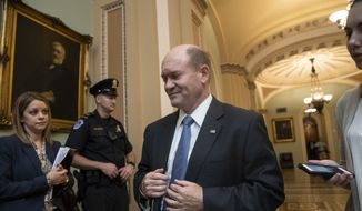 Sen. Chris Coons, D-Del., a member of the Senate Judiciary Committee, arrives at the chamber. (AP Photo/J. Scott Applewhite)