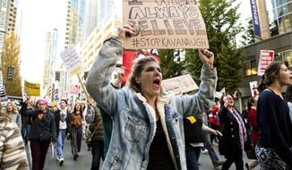 In this Thursday, Oct. 4, 2018, photo, Laura Dennis marches with hundreds of other protesters through downtown Seattle in opposition to the nomination of Brett Kavanaugh to the U.S. Supreme Court. (Rebekah Welch/The Seattle Times via AP)