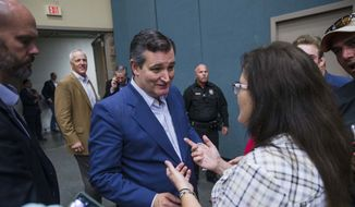 In this Wednesday, Oct. 3, 2018, photo, Annette Bever, 49, speaks with U.S. Sen. Ted Cruz, R-Texas, during his campaign stop with Donald Trump Jr. in Wichita Falls, Texas. (Amanda Voisard /Austin American-Statesman via AP) ** FILE **
