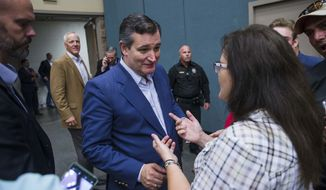 In this Wednesday, Oct. 3, 2018 photo,  Annette Bever, 49, speaks with U.S. Sen. Ted Cruz, R-Texas, during his campaign stop with Donald Trump Jr.  in Wichita Falls, Texas. (Amanda Voisard /Austin American-Statesman via AP)