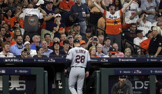 Cleveland Indians starting pitcher Corey Kluber (28) walks to the dugout after he was pulled from the game during the fifth inning in Game 1 of an American League Division Series baseball game against the Houston Astros, Friday, Oct. 5, 2018, in Houston. (AP Photo/David J. Phillip)