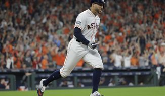 Houston Astros' George Springer celebrates his solo home run against Cleveland Indians pitcher Corey Kluber during fifth inning in Game 1 of an American League Division Series baseball game Friday, Oct. 5, 2018, in Houston. (AP Photo/David J. Phillip)