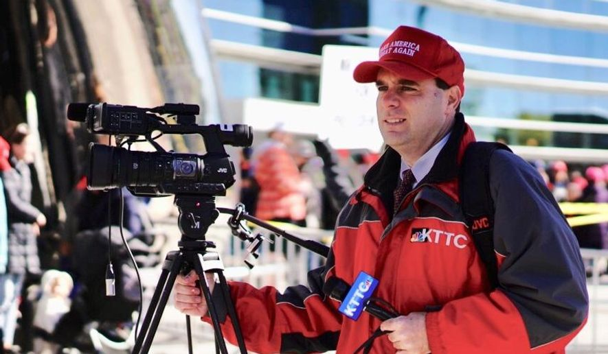 "In this Thursday, Oct. 4, 2018 photo, KTTC-TV multimedia journalist James Bunner wears a ""Make America Great Again"" hat while interviewing people waiting to see President Donald Trump in Rochester, Minn. News Director Noel Sederstrom says the station does not allow staff members to cover stories while wearing apparel from political campaigns. Sederstrom says Bunner was fired. (Mark Vancleave/Star Tribune via AP)"