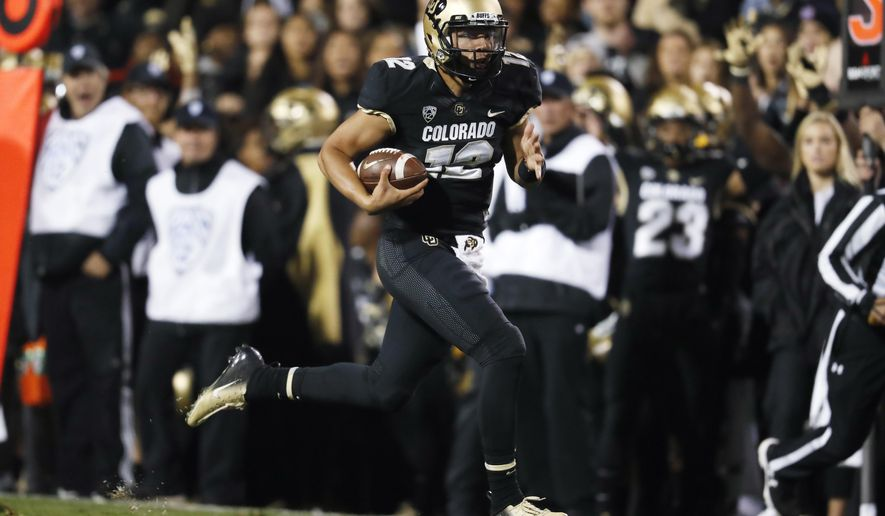 FILE - In this Sept. 28, 2018, file photo, Colorado quarterback Steven Montez runs for a touchdown against UCLA during the second half of an NCAA college football game, in Boulder, Colo. The Buffaloes (4-0, 1-0) host Arizona State (3-2, 1-0) Saturday with the chance to prove their best start in 20 years isn't a product of an early-season schedule that turned softer than anyone imagined.(AP Photo/David Zalubowski, File)