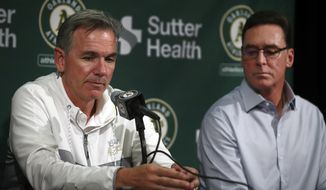 Oakland Athletics' Executive VP of Baseball Operations Billy Beane, left, and Manager Bob Melvin answer questions from reporters during a media conference Friday, Oct. 5, 2018, in San Francisco. After a 97-65 regular season, Oakland lost the wild-card game 7-2 to New York on Wednesday night at Yankee Stadium. (AP Photo/Ben Margot)