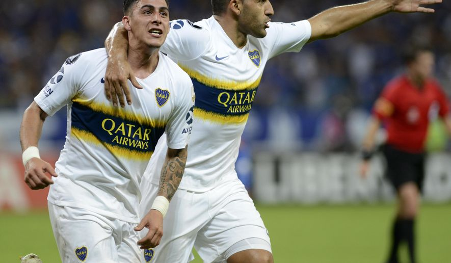 CORRECTS TEAMMATE IN CELEBRATION - Cristian Pavon of Argentina's Boca Juniors, left, celebrates with teammate Ramon Abila, after scoring against Brazil's Cruzeiro during a quarter finals Copa Libertadores soccer match in Bello Horizonte, Brazil, Thursday, Oct. 4, 2018. (AP Photo/Eugenio Savio)