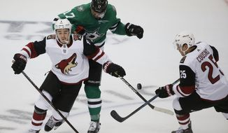 Dallas Stars center Devin Shore (17) defends against Arizona Coyotes center Clayton Keller (9) and center Derek Stepan (21) during the third period of an NHL hockey game in Dallas, Thursday, Oct. 4, 2018. The Stars defeated the Coyotes 3-0. (AP Photo/Michael Ainsworth)