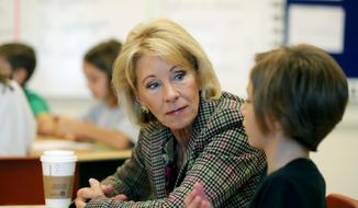 Education Secretary Betsy DeVos visits a classroom at the Edward Hynes Charter School in New Orleans, Friday, Oct. 5, 2018. (AP Photo/Gerald Herbert)