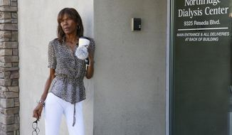 ADVANCE FOR RELEASE SATURDAY, OCT. 6, 2018, AND THEREAFTER - In this Sept. 27, 2018, photo Tangi Foster stands outside the Northridge Dialysis Center where she receives dialysis in Northridge, Calif. A ballot measure restricting profits at dialysis clinics has overtaken both the gas tax and rent control initiatives to become the most expensive California proposition this cycle. Foster, is working with the union to promote Proposition 8. She said she believes dialysis clinics prioritize profits over patients and pointed to the spending by the providers as evidence. (AP Photo Damian Dovarganes)