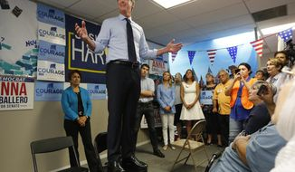 ADVANCE FOR RELEASE SATURDAY, OCT. 6, 2018, AND THEREAFTER - FILE - In this Sept. 12, 2018, file photo California gubernatorial candidate. Lt. Gov. Gavin Newsom, a Democrat, stands on a chair as he addresses supporters, during a stop in Modesto, Calif. California's race for governor pits Newsom, a Democrat and former San Francisco mayor, against Republican businessman John Cox. (AP Photo/Rich Pedroncelli, File)