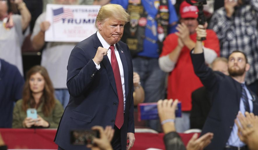 President Donald Trump pumps his fist as he leaves after speaking at a campaign rally Thursday, Oct. 4, 2018, in Rochester, Minn. (AP Photo/Jim Mone)