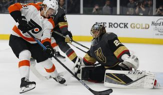 Philadelphia Flyers left wing Oskar Lindblom (23) scores against Vegas Golden Knights goaltender Marc-Andre Fleury during the first period of an NHL hockey game Thursday, Oct. 4, 2018, in Las Vegas. (AP Photo/John Locher)