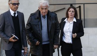 French actor Jean-Paul Belmondo, center, arrives to a ceremony to pay tribute to late singer Charles Aznavour, Friday, Oct.5, 2018 in Paris. Aznavour, the French crooner and actor whose performing career spanned eight decades and who seduced fans around the world with his versatile tenor, lush lyrics and kinetic stage presence, has died. He was 94. (AP Photo/Christophe Ena, Pool)