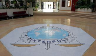 FILE - This Oct.16, 2007 file photo shows the entrance hall of Interpol's headquarters in Lyon, central France. A French judicial official says Friday Oct.5, 2018 the president of Interpol has been reported missing after traveling to China. The official, who spoke on condition of anonymity for an ongoing investigation, said Meng Hongwei's wife reported him missing on Friday. (AP Photo/Laurent Cipriani, File)