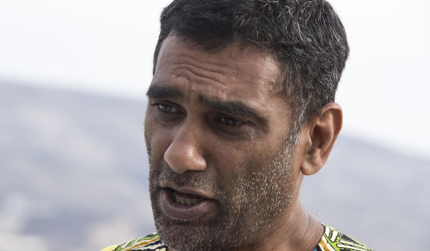 Amnesty International's new Secretary General, Kumi Naidoo speaks in Athens, on Friday, Oct. 5, 2018. Naidoo, told The Associated Press in an interview that debate around Trump Administration policies had energized campaigns on climate change and woman's equality.Naidoo was in Greece to visit a severely overcrowded refugee camp on the island of Lesbos.(AP Photo/Petros Giannakouris)