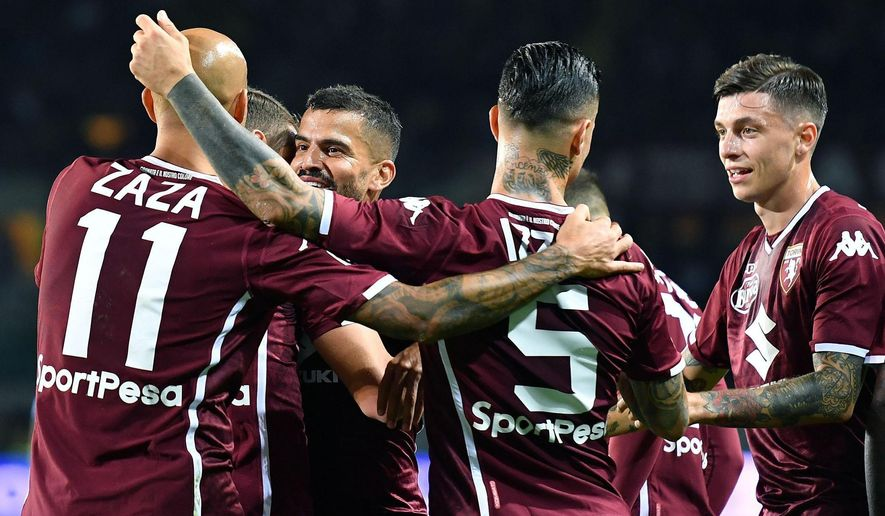 Torino's Tomas Rincon, third from left, face to the camera, celebrates  with his teammates after scoring during the Italian Serie A soccer match between Torino and Frosinone at  Calcio at the Olimpico Grande Torino  stadium in Turin, Italy,  Friday, Oct. 5, 2018. (Alessandro Di Marco/ANSA via AP)