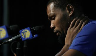 Golden State Warriors' Kevin Durant listens to a question from a reporter before the team's NBA preseason basketball game against the Sacramento Kings, Friday, Oct. 5, 2018, in Seattle. (AP Photo/Ted S. Warren)