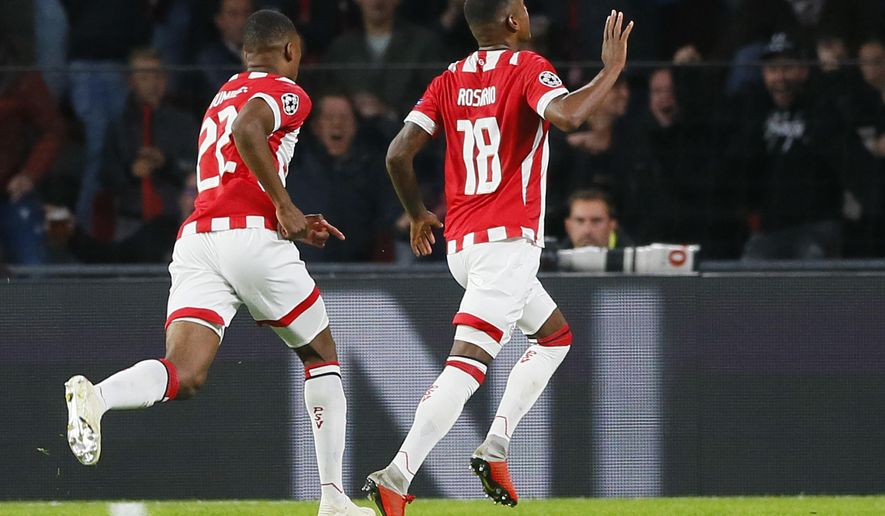 PSV's Denzel Dumfries, left, celebrates with teammate Pablo Rosario, right, who scored his side's first goal during a Group B Champions League soccer match between PSV and Inter Milan at the Philips stadium in Eindhoven, Netherlands, Wednesday, Oct. 3, 2018. (AP Photo/Peter Dejong)