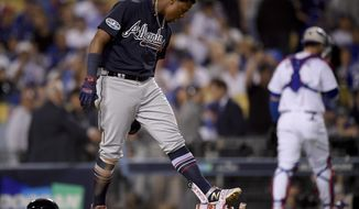 Atlanta Braves' Ronald Acuna Jr. reacts after striking out during the eighth inning against the Los Angeles Dodgers in Game 1 of a baseball National League Division Series on Thursday, Oct. 4, 2018, in Los Angeles. (AP Photo/Mark J. Terrill)