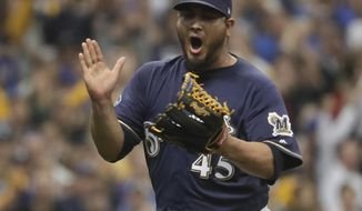 Milwaukee Brewers starting pitcher Jhoulys Chacin reacts after Colorado Rockies' Trevor Story strikes out during the first inning of Game 2 of the National League Divisional Series baseball game Friday, Oct. 5, 2018, in Milwaukee. (AP Photo/Morry Gash)