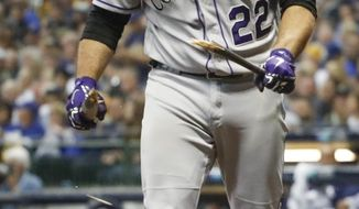 Colorado Rockies' Chris Iannetta (22) breaks his bat after striking out during the seventh inning of Game 2 of the National League Divisional Series baseball game against the Milwaukee Brewers Friday, Oct. 5, 2018, in Milwaukee. (AP Photo/Jeff Roberson)