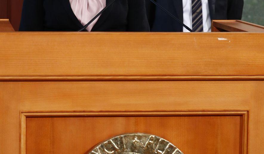 The chairman of the Norwegian Nobel Peace Prize Committee, Berit Reiss-Andersen, left, and the committee secretary Olav Njolstad, announce the 2018 Nobel Peace Prize in the Nobel Institute in Oslo, Friday, OCt. 5, 2018. The Nobel Peace Prize committee awarded The 2018 Nobel Peace Prize to Denis Mukwege and Nadia Murad. (Terje Pedersen/NTB Scanpix via AP)