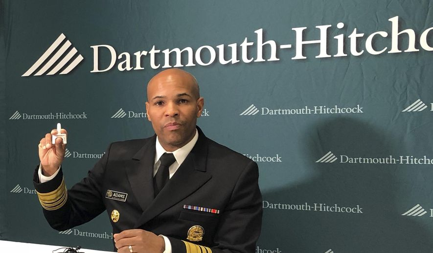 U.S. Surgeon General Jerome Adams holds up a nasal spray dose of naloxone, an opioid overdose-reversing drug in Concord, N.H., on Friday, Oct. 5, 2018. Adams was the keynote speaker at a conference organized by Dartmouth-Hitchcock Medical Center about the effects of the opioid crisis on children and families. (AP Photo/Holly Ramer) ** FILE **