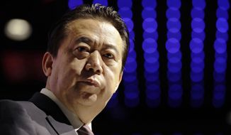 In this July 4, 2017, file photo, Interpol President, Meng Hongwei, delivers his opening address at the Interpol World congress in Singapore. A French judicial official says Friday Oct.5, 2018 the president of Interpol has been reported missing after traveling to China. (AP Photo/Wong Maye-E, File)