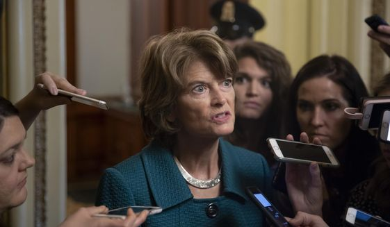 Republican Sen. Lisa Murkowski of Alaska, speaks with reporters just after a deeply divided Senate pushed Brett Kavanaugh's Supreme Court nomination past a key procedural hurdle, setting up a likely final showdown vote for Saturday, at the Capitol in Washington, Friday, Oct. 5, 2018. (AP Photo/J. Scott Applewhite)