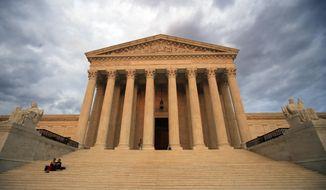 The U.S. Supreme Court is seen at near sunset in Washington, Thursday, Oct. 4, 2018. (AP Photo/Manuel Balce Ceneta)