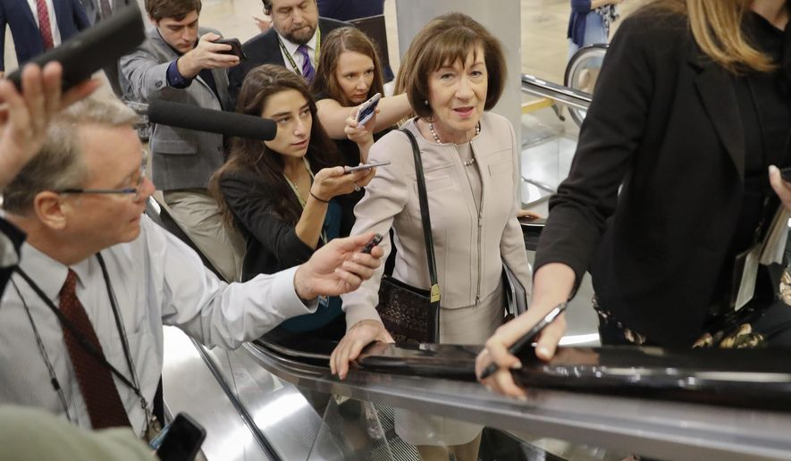 Sen. Susan Collins, R-Maine, is followed by members of the media as she walks to the Capitol before a vote to advance Brett Kavanaugh's nomination to the Supreme Court, on Capitol Hill, Friday, Oct. 5, 2018 in Washington. (AP Photo/Pablo Martinez Monsivais)