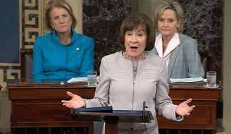 In this image from video provided by Senate TV, Sen. Susan Collins, R-Maine., speaks on the Senate floor about her vote on Supreme Court nominee Judge Brett Kananaugh, Friday, Oct. 5, 2018 in the Capitol in Washington.  Sen Shelly Capito, R-W.Va., sits rear left and Sen. Cindy Hyde-Smith, R-Miss., sits right.  (Senate TV via AP) ** FILE **