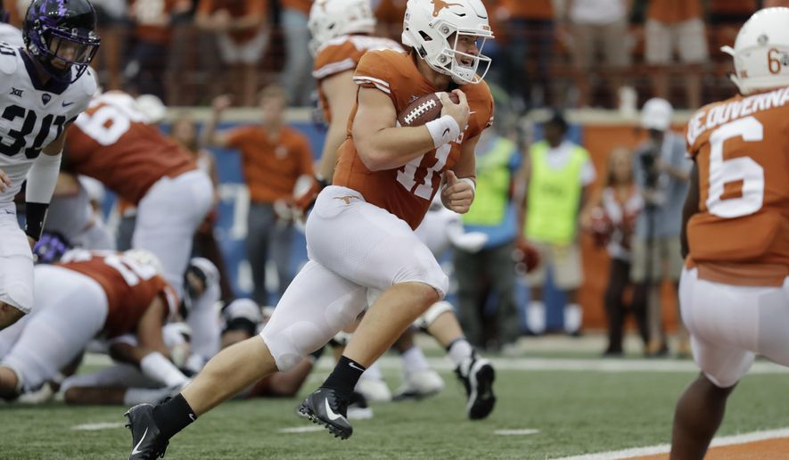 FILE - In this Sept. 22, 2018, file photo, Texas quarterback Sam Ehlinger (11) runs for a 2-yard touchdown against TCU during the second half of an NCAA college football game in Austin, Texas. Ehlinger has thrown for at least 200 yards and a touchdown in the first five games, becoming just the fourth Texas quarterback to do that--and the first in a decade. Texas plays Oklahoma this week. (AP Photo/Eric Gay, File)