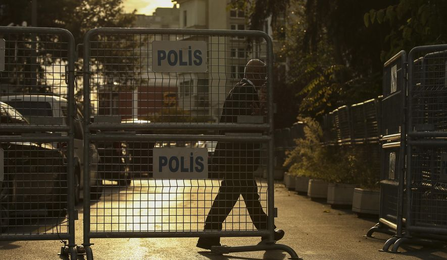 A security guard closes the entrance to a blocked road leading to the Saudi Arabia consulate in Istanbul, Thursday, Oct. 4, 2018. Saudi Arabia's Consulate in Istanbul insisted Thursday that a missing Saudi contributor to The Washington Post left its building before disappearing, directly contradicting Turkish officials who say they believe the writer is still inside. The comments further deepen the mystery surrounding what happened to Jamal Khashoggi, who had been living in a self-imposed exile in the U.S. while writing columns critical of the kingdom and its policies under upstart Crown Prince Mohammed bin Salman. (AP Photo/Emrah Gurel)