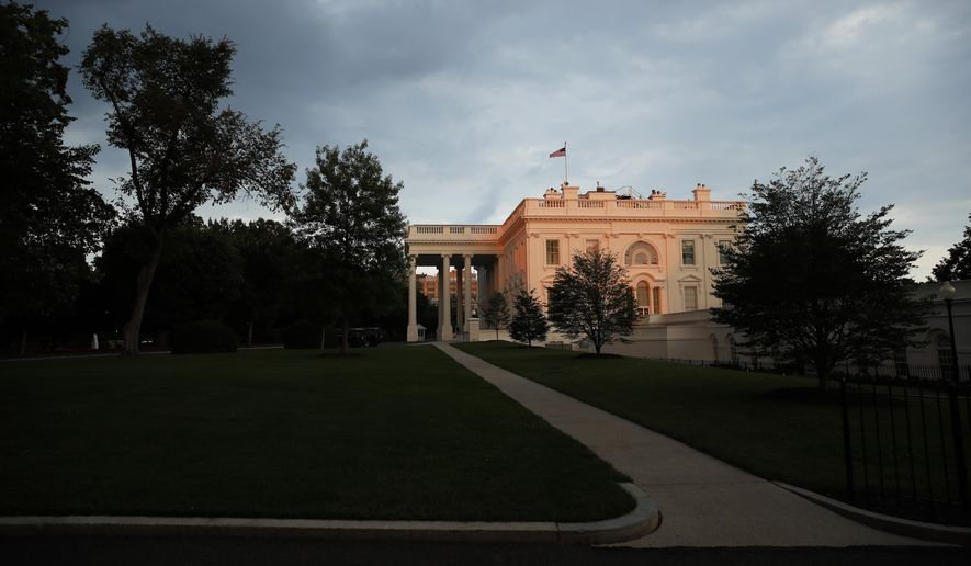 In this June 17, 2018, file photo, the White House is seen illuminated by the setting sun with storm clouds nearby in Washington. (AP Photo/Alex Brandon, File)