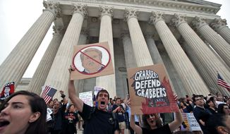 People protest on the steps of the Supreme Court after the confirmation vote of Supreme Court nominee Brett Kavanaugh, on Capitol Hill, Saturday, Oct. 6, 2018 in Washington. (AP Photo/Alex Brandon)