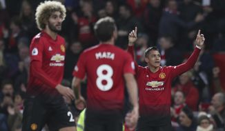 Manchester United's Alexis Sanchez celebrates after scoring his sides 3rd goal during their English Premier League soccer match between Manchester United and Newcastle United at Old Trafford in Manchester, England, Saturday, Oct. 6, 2018. (AP Photo/Jon Super)