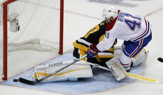 Montreal Canadiens' Paul Byron (41) scores against Pittsburgh Penguins goaltender Matt Murray (30) in the first period of an NHL hockey game in Pittsburgh, Saturday, Oct. 6, 2018. (AP Photo/Gene J. Puskar)