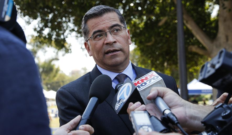 FILE - In this Aug. 2, 2018 file photo California Attorney General Xavier Becerra talks to reporters after a news conference at University of California, Los Angeles. Becerra California's first Latino attorney general last year after Kamala Harris left the job when she was elected to the U.S. Senate. Becerra, a long-time Los Angeles congressman, was a deputy state attorney general 30 years ago and said he would rather focus on the office's more traditional role of prosecuting bad guys and protecting consumers. (AP Photo/Jae C. Hong, File)