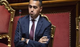 Italian Deputy Premier and Labour Minister Luigi Di Maio speaks during a question time session at the Senate, in Rome, Thursday, Oct. 4, 2018. Stocks in Europe rose after Italy's economy minister backed down on spending plans that would keep the country's deficit at an elevated level for three years. That relieved investors who were worried about Italy's debts and the possibility of tensions between the country and the European Union. (Maurizio Brambatti/ANSA via AP)