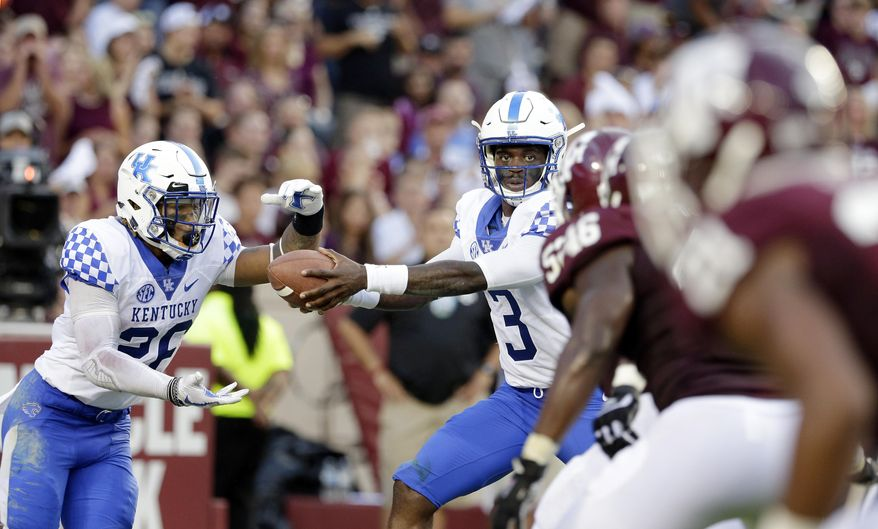 Kentucky running back Benny Snell Jr. (26) takes a hand off from quarterback Terry Wilson (3) during the first half of an NCAA college football game against the Texas A&M, Saturday, Oct. 6, 2018, in College Station, Texas. (AP Photo/Michael Wyke)