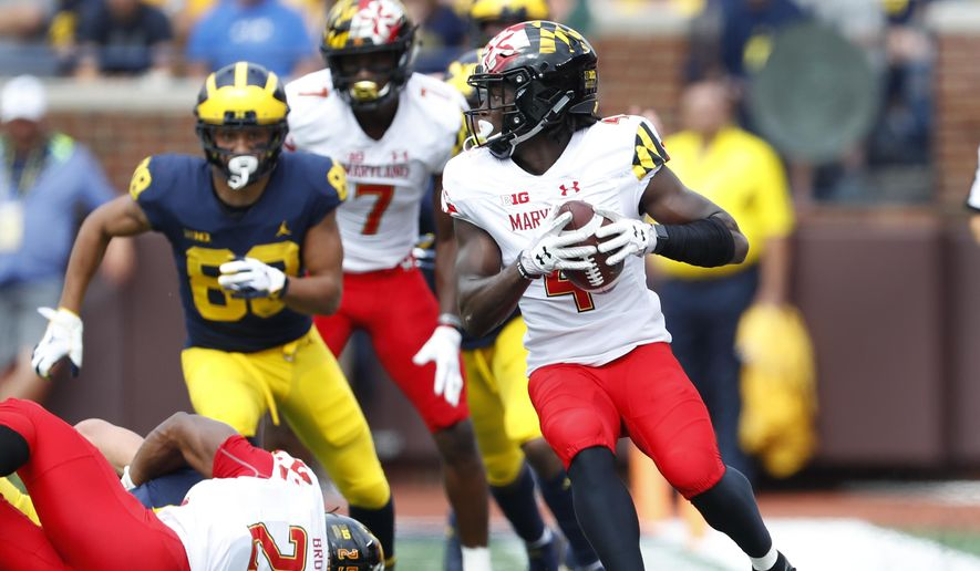 Maryland defensive back Darnell Savage Jr. (4) intercepts a Michigan pass in the first half of an NCAA football game in Ann Arbor, Mich., Saturday, Oct. 6, 2018. (AP Photo/Paul Sancya) ** FILE **