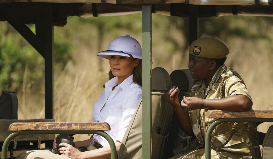 First lady Melania Trump looks out over Nairobi National Park in Nairobi, Kenya, Friday, Oct. 5, 2018, during a safari guided by Nelly Palmeris, right. Mrs. Trump is visiting Africa on her first big solo international trip. (AP Photo/Carolyn Kaster)