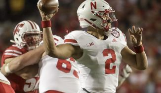 Nebraska's Adrian Martinez throws during the second half of an NCAA college football game against Wisconsin Saturday, Oct. 6, 2018, in Madison, Wis. (AP Photo/Morry Gash)