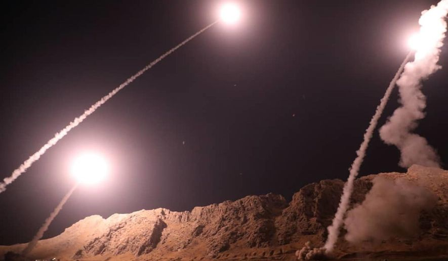 In this photo released by the Iranian Revolutionary Guard on Monday, Oct. 1, 2018, missiles are fired from the city of Kermanshah in western Iran targeting the Islamic State group in Syria. Iran's paramilitary Revolutionary Guard said Monday it launched ballistic missiles into eastern Syria targeting militants it blamed for a recent attack on a military parade. (Sepahnews via AP) **FILE**