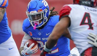 Boise State running back Alexander Mattison (22) runs with the ball against San Diego State in the first half of an NCAA college football game, Saturday, Oct. 6, 2018, in Boise, Idaho. (AP Photo/Steve Conner)