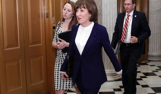 Sen. Susan Collins, R-Maine, heads to the Senate floor for the vote on the confirmation vote of Supreme Court nominee Brett Kavanaugh, on Capitol Hill, Saturday, Oct. 6, 2018 in Washington. (AP Photo/Alex Brandon)