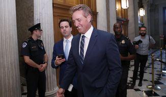 Sen. Jeff Flake, R-Ariz., heads to the Senate floor for the confirmation vote of Supreme Court nominee Brett Kavanaugh, on Capitol Hill, Saturday, Oct. 6, 2018 in Washington. (AP Photo/Alex Brandon)